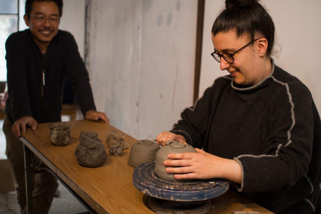 Japanese artist Takeshi Tanaka teaching ceramics in Onishi Japan