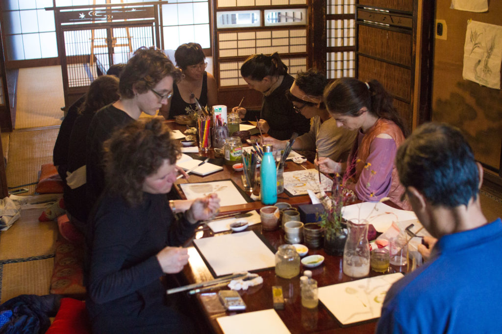 Artists learning about traditional Japanese painting or Nihonga from Taiwanese artist Chika Wang