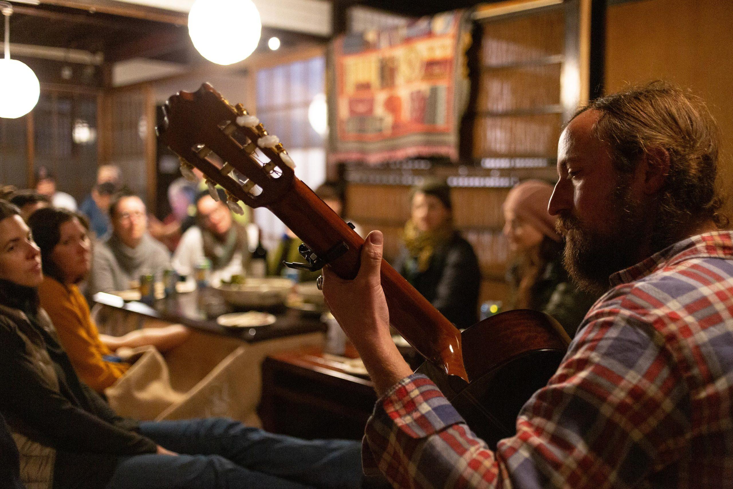 Paul DeHaven plays guitar in Onishi, Japan